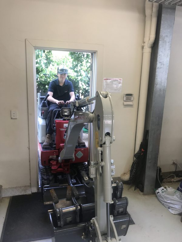 Mini Excavtor going through doorway